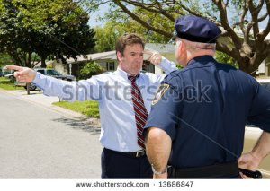 stock-photo-unhappy-motorist-forced-to-take-a-field-sobriety-test-by-an-angry-police-officer-13686847